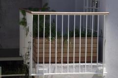 Balau-planters-with-balau-handrail-to-steel-fence-balustrade