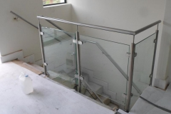 Clamped-toughened-glass-tested-to-withstand-400-joule-impact