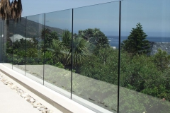 Finished-glass-ballustrade-with-no-handrail-with-prestine-neatne