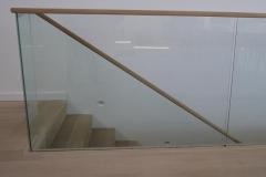 Glass-Ballustrade-oak-handrail-bonded-directly-to-glass-balustra