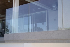 Glass-ballustrade-casted-into-narrow-concrete-upstand-and-coated