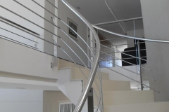 Tapered-spiral-shape-staircase-balustrade-meets-straight-polishe