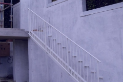 Treated-steel-staircase-with-balustrade-and-stringer-on-one-side