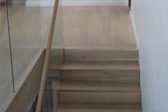 Wood-cladded-Staircase-and-balustrade-with-handrailng-to-match