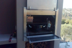 Built-in-braai-cladded-with-stainless-steel-and-ready-to-be-enjo