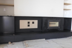 Fireplace-all-cladded-with-mild-steel-plates-to-give-it-a-soli