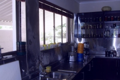 Kitchen-cladded-with-stainless-steel-sheeting-making-cleaning-ea