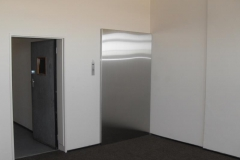 Super-mirror-finish-stainless-steel-cladding-on-a-lift-door