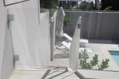 Safety-glass-gate-at-top-of-staircase-on-the-patio