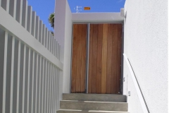 Wood-and-mild-steel-entrance-gate-with-side-panel