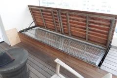 Storage-chest-hidden-under-timber-bench