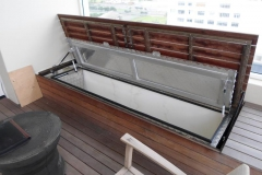 Water-tight-storage-chest-at-pool-area-with-wood-cladding-to-hid