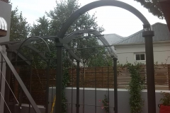 Galvanised-mild-steel-pergola-with-a-chapel-looking-roof-painted