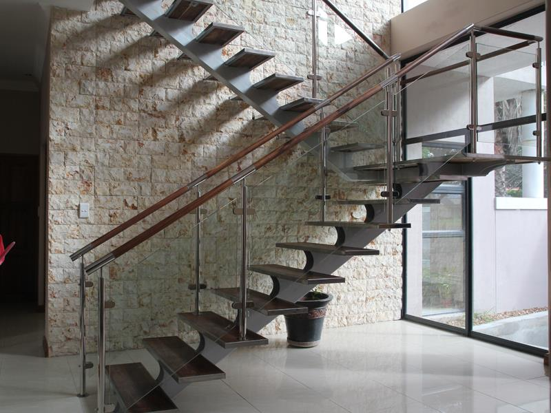 Stainless Steel Staircase With Wooden Treads And Glass