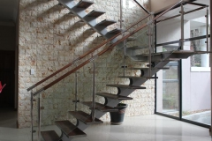 Stainless-Steel-Staircase-with-wooden-treads-and-glass-ballustra