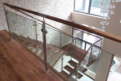 Stainless-staircase-timber-treads-and-glass-ballustrade-create