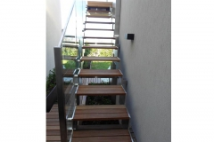 Stainless-steel-cladded-staircase-and-timber-decking-is-blending