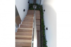 Stainless-steel-cladding-staircase-and-timber-treads-connecting