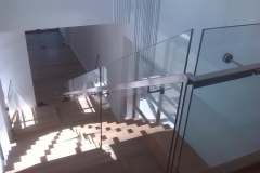 Stainless-steel-handrail-mounted-to-glass-ballustrade