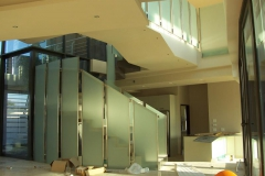 Staircase-with-frosted-glass-ballustrades