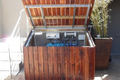 Pool-pump-in-timber-cover-open-lid